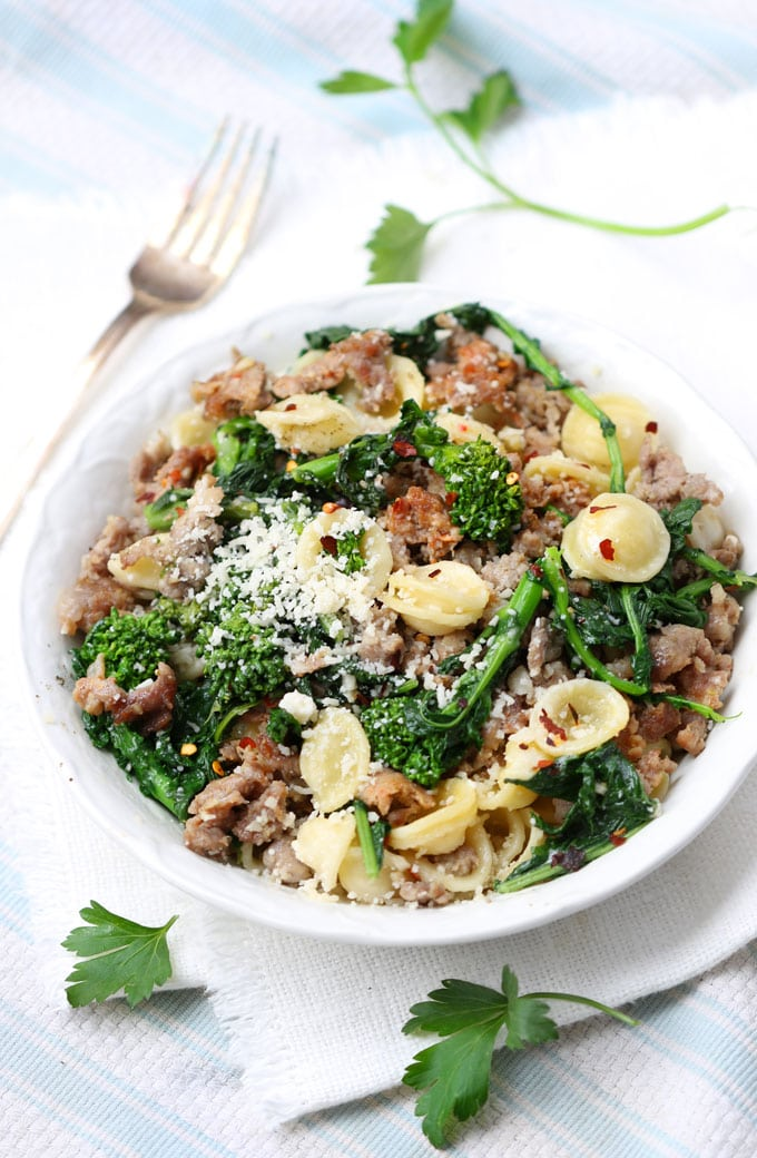 A spicy, flavorful main course pasta dish from New York's famous Italian restaurant Rao's - Orecchiette with hot and sweet Italian sausages, lots of garlic, broccoli rabe and Pecorino cheese.