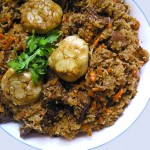 Plov, a popular dish in Uzbekistan, is like risotto meets lamb stew - a delicious festive dish of tender lamb, rice, carrots, onions and wonderful spices.