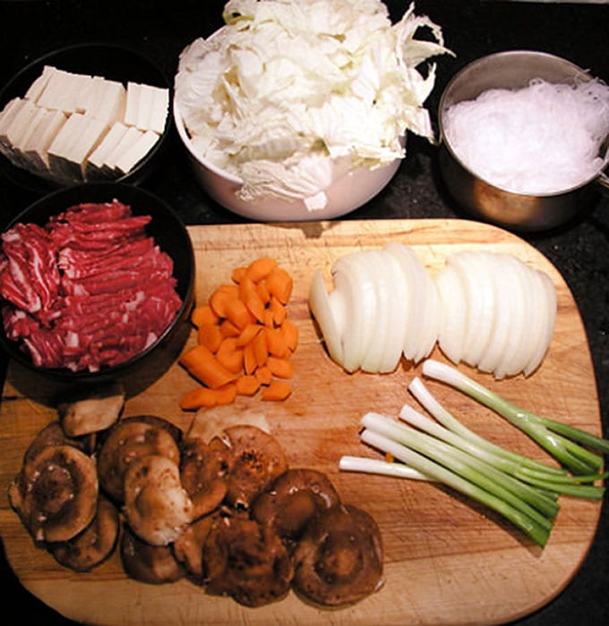 It's easy to make Sukiyaki at home. Just some slicing and dicing and ten minutes of simmering and you will have a delicious Japanese hot pot brimming with beef, rice noodles, tofu and vegetables, in a sweet soy broth l Panning The Globe Recipe