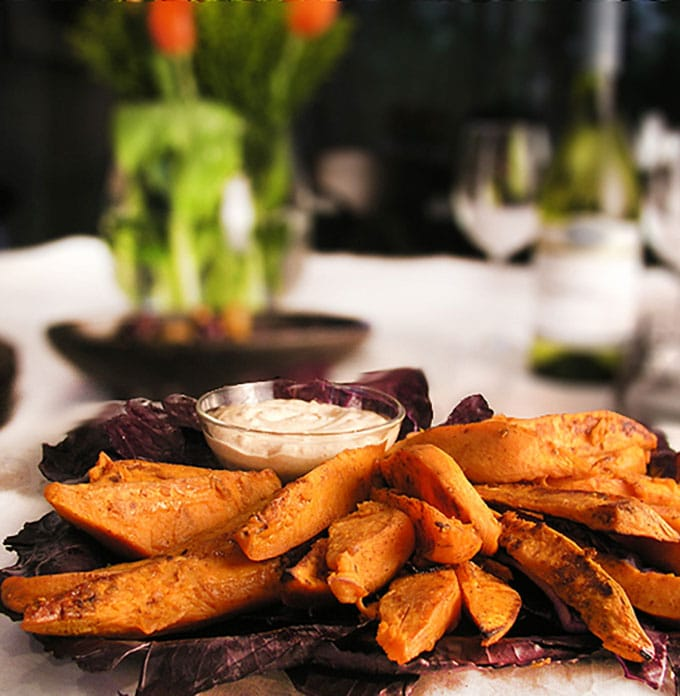 Sweet and spicy oven-baked sweet potato wedges with chipotle aioli dipping sauce! An addictively delicious healthy appetizer or game day treat.