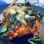 one slice of eggplant parmesan topped with spinach and cheese