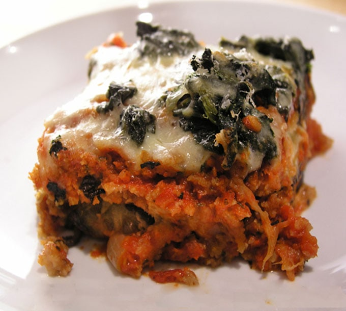 This no-fry eggplant parmigiana has the deliciousness of classic eggplant parmesan but it's way healthier, made with baked eggplant and spinach topping.
