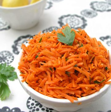 Moroccan Raw Carrot Salad Recipe: Shredded carrots tossed with olive oil, lemon juice, cumin and garlic - a great side dish in 15 minutes!