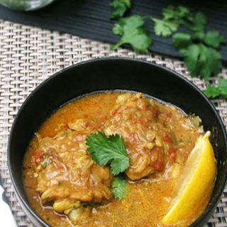 This one pot coconut chicken curry recipe highlights the deliciousness of East African cuisine. Chicken thighs are simmered coconut curry sauce with ginger, garlic, crushed tomatoes and fragrant spices, and topped with crushed peanuts and chopped cilantro for a tasty final layer of flavor.