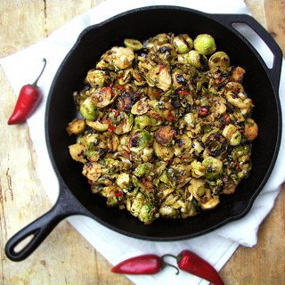 Crisp browned brussels sprouts with scallions and chilies in a maple soy chili sauce. | Panning The Globe