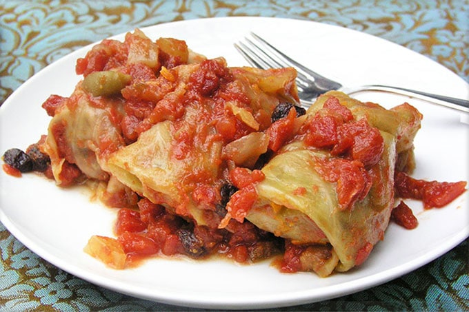 Russian Stuffed Cabbage: Ground beef with rice and vegetables, wrapped in cabbage leaves and braised in a sweet and sour tomato sauce - step by step instructions | Panning The Globe