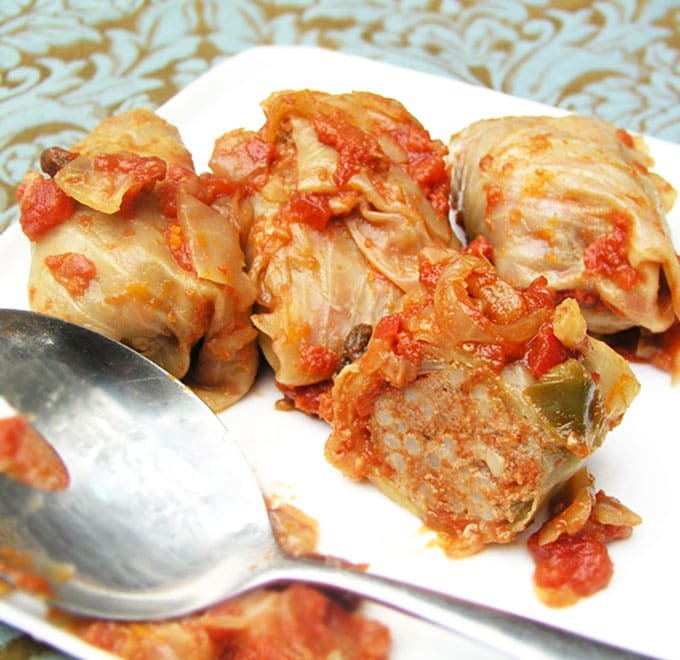 An authentic recipe for Russian Stuffed Cabbage: beef and rice rolled in cabbage leaves and braised in a sweet and sour tomato sauce. Make ahead. | Panning The Globe