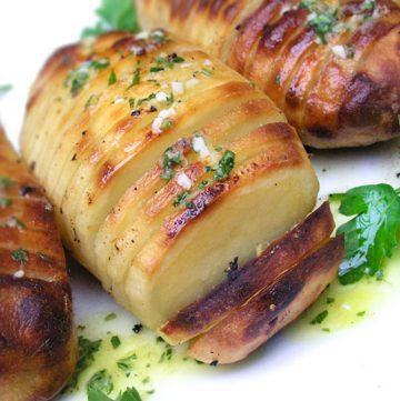 Hasselback Potatoes with Lemon Garlic Dijon Vinaigrette Baked in. Crisp on the outside, creamy inside, bursting with flavor.