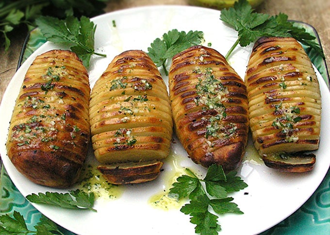 Swedish Hasselback Potatoes with lemon garlic dijon vinaigrette baked in. Learn how to transform an ordinary potato into something spectacular | Panning The Globe