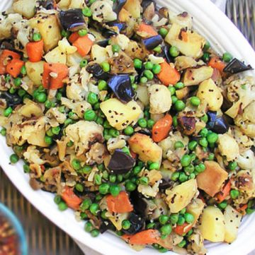 Roasted Vegetables get a delicious boost of flavor with spices from Zanzabar. Carrots, potatoes, eggplant and cauliflower, roasted then briefly stewed with peas and exotic African spices.