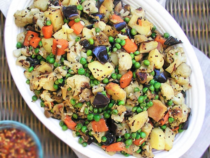 Roasted vegetables get a delicious flavor boost with wonderful East African spices. This is an exceptional side dish! l panningtheglobe.com