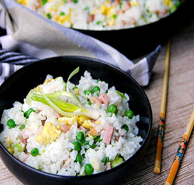 This authentic Chinese ham and egg fried rice recipe has only 5 ingredients, plus oil to stir-fry and salt to season, and no soy sauce. You haven't tasted great fried rice until you've tried this recipe. It's the absolute best!