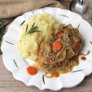 Smothered Chicken with Vinegar is the most tender falling-apart chicken, smothered with celery, onions and carrots, and braised in rosemary and garlic scented vinegar sauce. Serve over mashed potatoes to soak up all the delicious sauce.