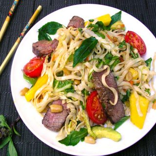 This Thai Steak and Noodle Salad is a one-dish dinner salad with avocado, mango, basil, rice noodles, peanuts...it's got that famous Thai balance of sweet, sour, spicy, tangy, tender, crunchy, delicious!