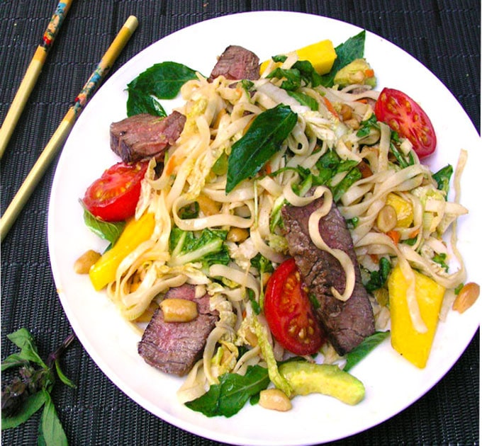 This Thai Steak and Noodle Salad is a one-dish dinner salad with avocado, mango, basil, rice noodles, peanuts...it's got that famous Thai balance of sweet, sour, spicy, tangy, tender, crunchy - delicious!