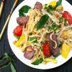 White plate with Thai steak and noodles salad
