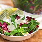 Here's a salad to brighten your day. Italy's famous Insalata Tricolore mimics the colors of the Italian flag. There are no frills, just a bowl of lettuces, a mustard-lemon vinaigrette, and a garnish of shaved parmesan. This salad works so well because of the strong personality of each type of lettuce, and how well they complement each other.