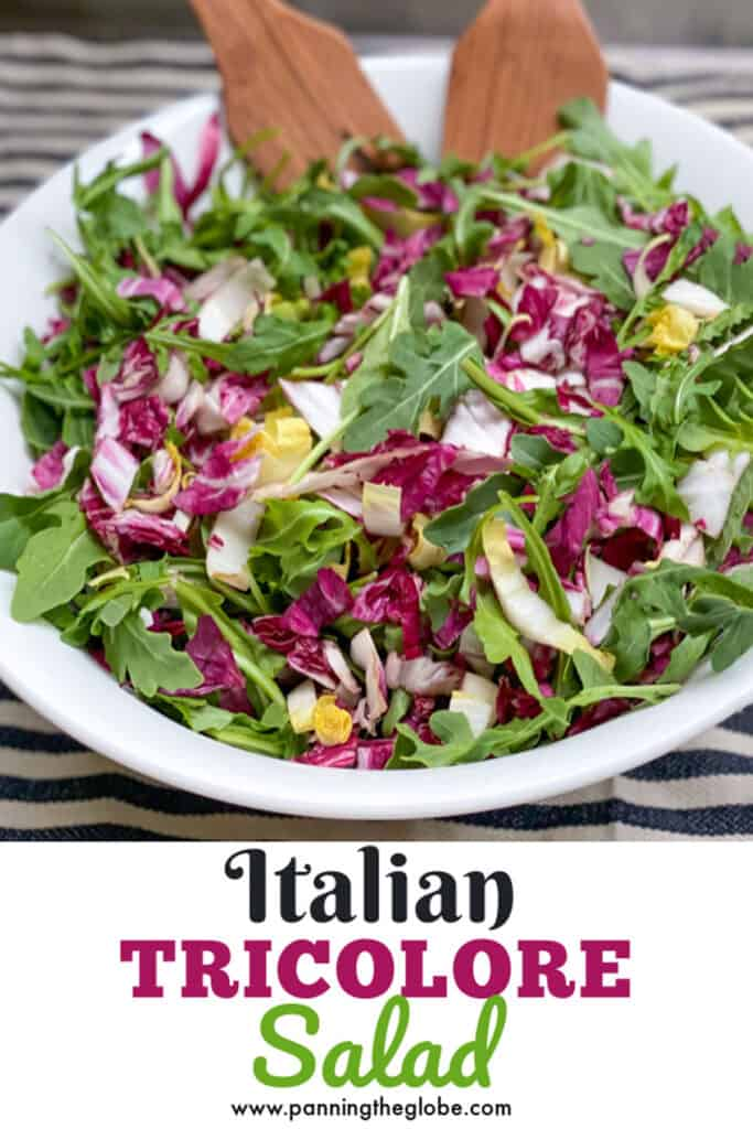 Pinterest pin: Italian Tricolore salad in a white bowl with wooden salad forks