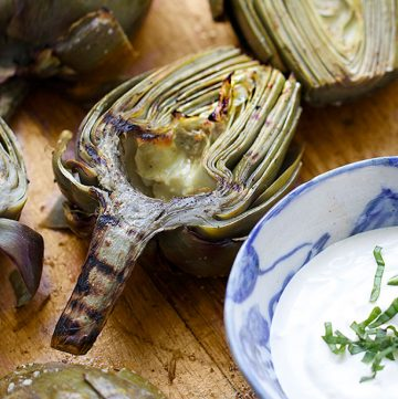 Grilled Artichokes are a fabulous appetizer for summer entertaining! You can do all the prep ahead of time. Just pop them on the grill right before serving. Grilling intensifies their wonderful flavor and the lemony aioli is the perfect companion.