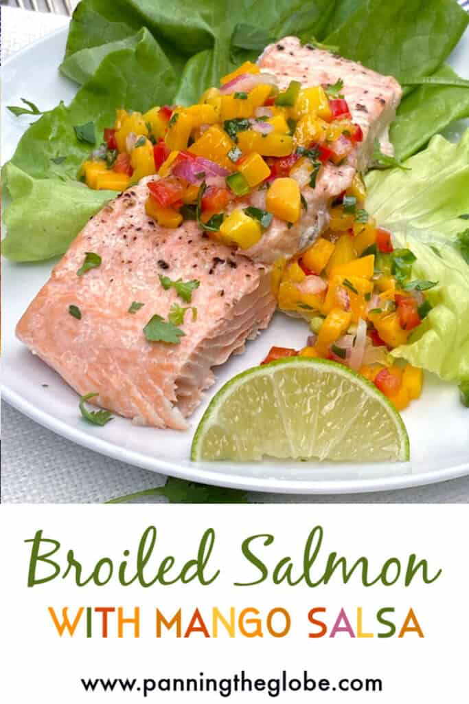 one serving piece of broiled salmon fillet on a bed of butter lettuce, topped with mango salsa