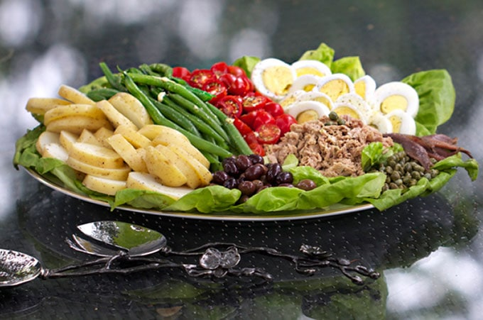Salad Niçoise is a popular French composed salad with tuna, potatoes, green beans, eggs and olives. It's a perfect salad for lunch, brunch or a dinner - beautiful, healthy and delicious.