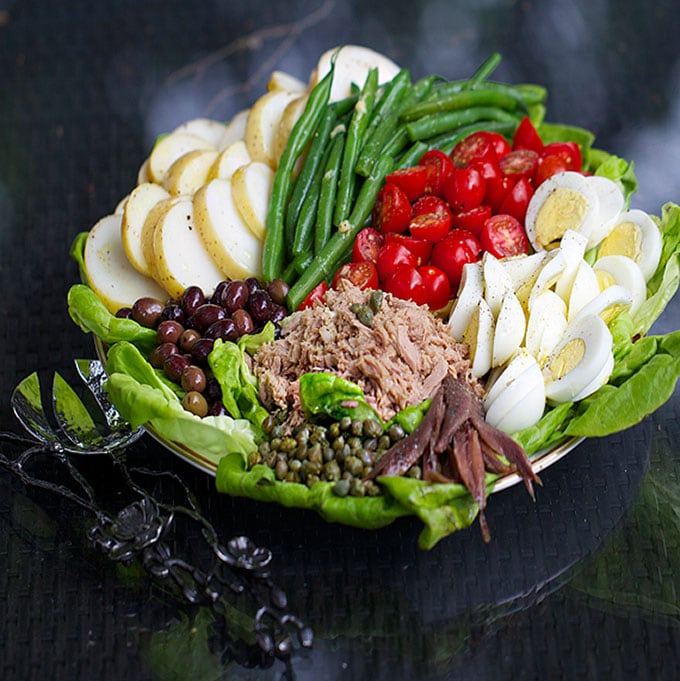 Salad Niçoise is a popular French composed salad with tuna, potatoes, green beans, eggs and Niçoise olives.