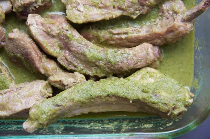 The ribs are steamed then marinated overnight so they soak up the flavors of coconut milk, lemongrass, cilantro, ginger, garlic...Just before serving, throw the ribs on the grill for a few minutes until golden brown and irresistible! This BBQ ribs recipe is the BEST for entertaining because all the work is done ahead l www.panningtheglobe.com