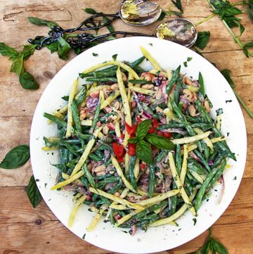 This three bean salad recipe is packed with delicious nutritious vegetables, fresh basil, and a and a tasty lemony yogurt dressing - panningtheglobe.com