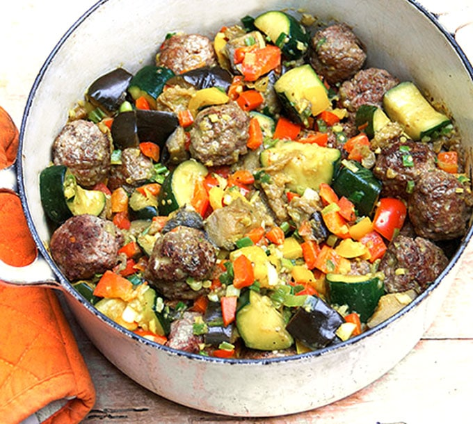This is a fantastic recipe from Chef Daniel Boulud for lamb meatballs and ratatouille braised together with fragrant Indian spices. It's a one-dish dinner with loads of great flavor l www.panningtheglobe.com