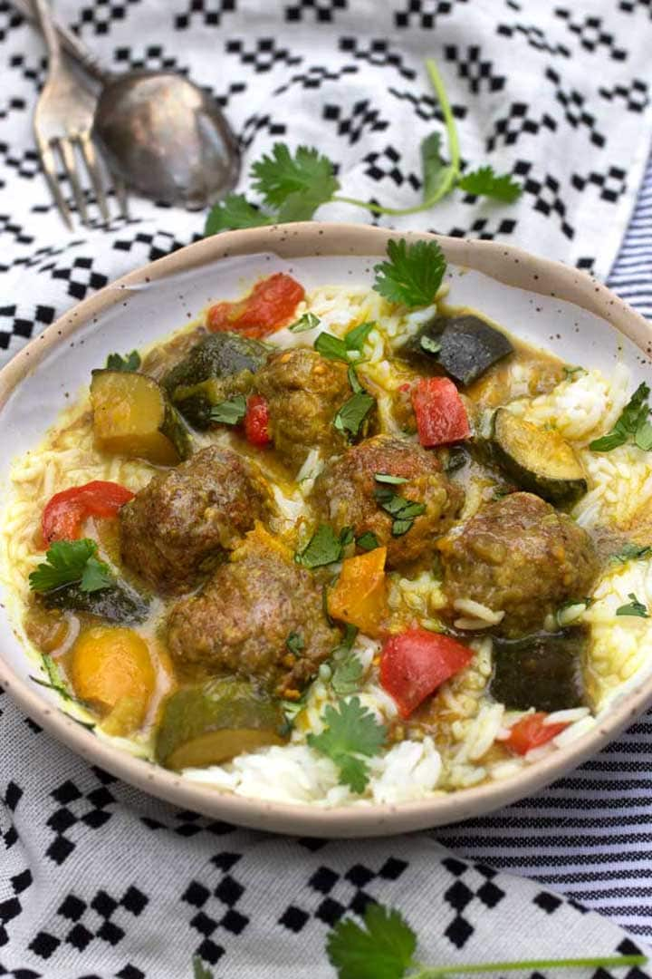 bowl of lamb meatballs and ratatouille stew