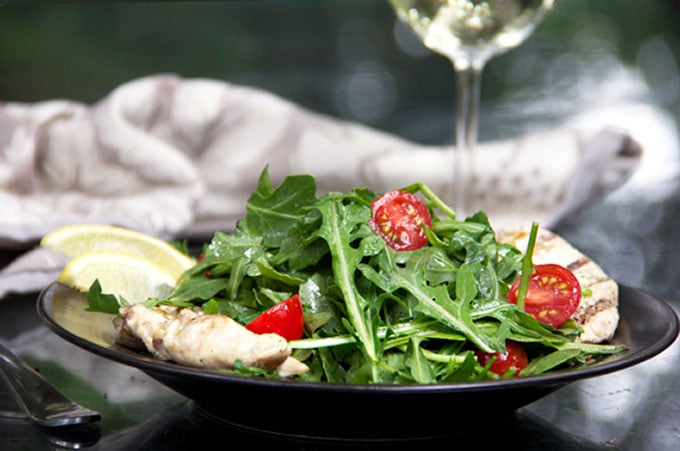Chicken paillard is an Italian classic that's perfect for grilling season: thinly pounded chicken marinated in lemony dressing, grilled, and topped with arugula salad and more lemony dressing. It's a quick ad easy recipe that's satisfying, healthy, and delicious.