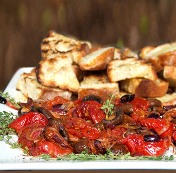 Roasted tomatoes and mushrooms with grilled bread is the absolute BEST spring and summer appetizer. It's like the most delicious bruschetta ever! - Panning The Globe Recipe
