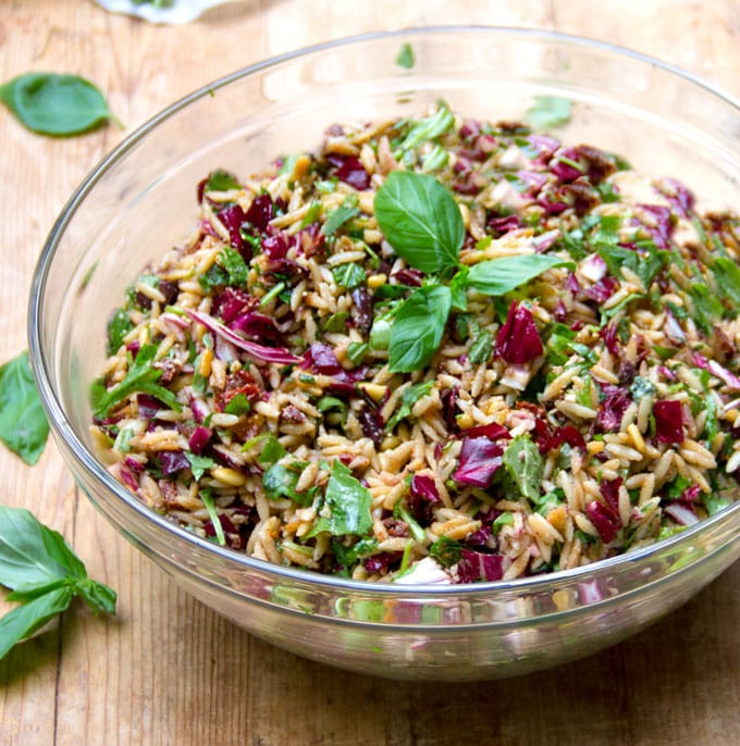 This is the best pasta salad recipe - orzo, chopped radicchio, basil, toasted pine nuts, sun dried tomatoes, kalamata olives, balsamic, garlic... Perfect for summer picnics and barbecues