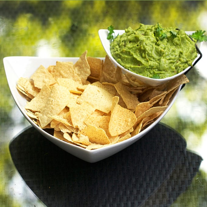 The best guacamole starts with perfectly ripe avocados, lemon or lime juice, fresh garlic and salt. Other tasty add-ins depend on your taste. Homemade guacamole is the absolute best and the recipe is easy l www.panningtheglobe.com
