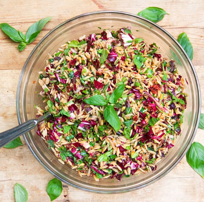 Out Of This World Pasta Salad Recipe: a spectacularly delicious pasta salad with orzo, chopped radicchio, basil, toasted pine nuts, sun dried tomatoes, kalamata olives, balsamic, garlic...