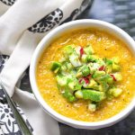 This Gazpacho can be made with yellow or red tomatoes. Serve it icy cold with the delicious topping of chopped cucumbers, radishes and avocados. The quintessential summer soup recipe l www.panningtheglobe.com