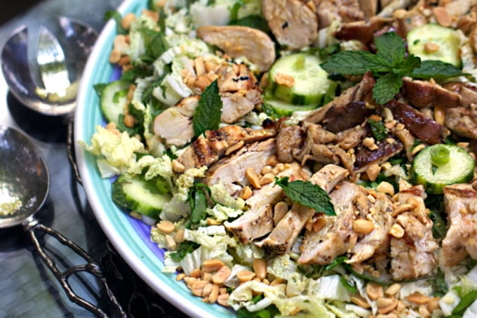 This Asian cabbage salad is what you want for dinner on a warm summer night, a refreshing and substantial dinner salad with cold crisp cucumbers, cabbage, spinach and mint tossed in an addictively good sesame-ginger-garlic dressing and topped with fresh-off-the-grill marinated chicken and shiitake mushrooms l www.panningtheglobe.com