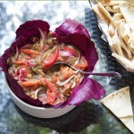 This roasted eggplant dip recipe is one of my favorite summer appetizers, and it's so simple to make. Just bake the eggplant, chop it, and mix it with sliced tomato and red onion plus some oil, vinegar, garlic, salt and pepper. Serve it with toasted pita points, tortilla chips or crackers.