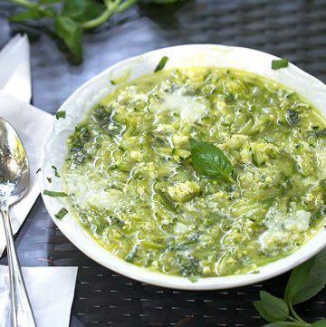 This Italian zucchini egg drop soup recipe has shredded zucchini, onions, garlic, parmesan and basil. It's hearty and bursting with fresh summery flavors.