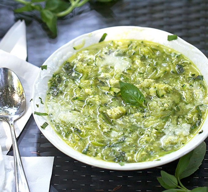 Italian zucchini egg drop soup recipe topped with basil