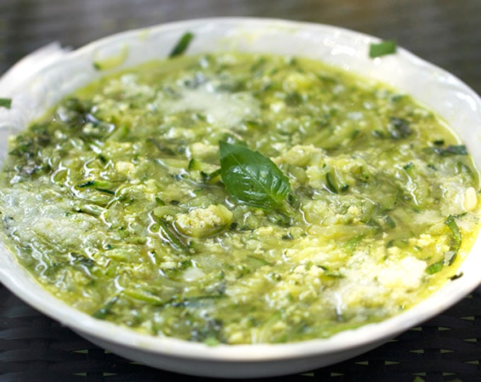 Close up bowl of Italian zucchini egg drop soup
