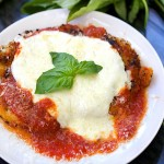 Chicken Parmesan - tender breaded chicken cutlets, crisp on the outside, drenched in delicious tomato sauce and topped with mozzarella cheese | Panning The Globe