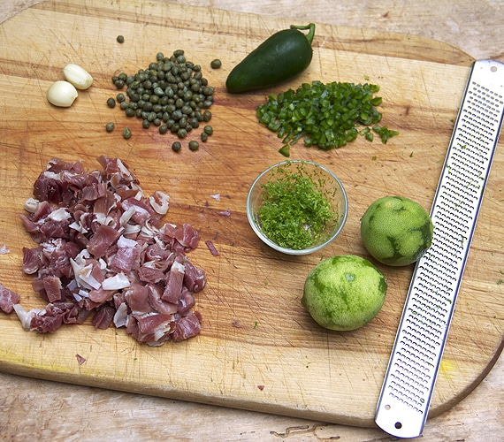 Ingredients for pasta with prosciutto, arugula and feta