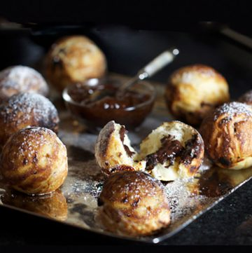 Aebleskivers are spherical pancakes from Denmark. They're extremely fun to make. You can fill them will delicious treats, sweet or savory. The room lights up with excitement when you bring out a platter of these festive pancake balls.