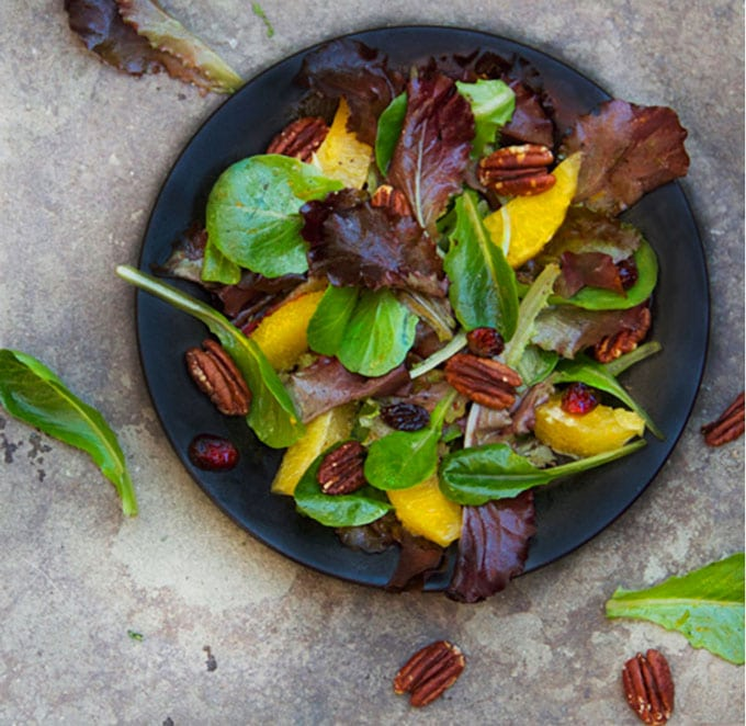 My favorite holiday salad, with mixed greens, toasted pecans and orange-cranberry vinaigrette - a perfect salad recipe for fall and winter entertaining.