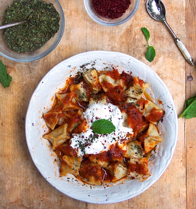 Turkish Manti: Tiny lamb-stuffed raviolis with three sauces - caramelized tomato sauce, brown butter sauce, garlicky yogurt sauce. A stellar dish for a special occasion | Panning The Globe