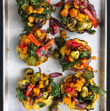 six Roasted Squash halves stuffed with a rainbow of roasted vegetables