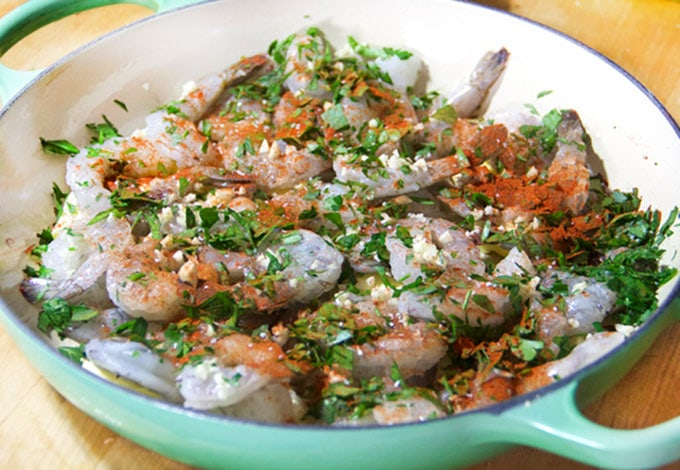 raw shrimp, garlic, parsley and spices in a casserole