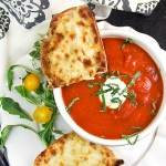 Grilled cheese with tomato soup is the ultimate comfort food pairing and the perfect lunch combo. Here's a special recipe for delicious spiced-up tomato soup and open-face oven grilled cheese with some special secret ingredients that make it extra tasty.