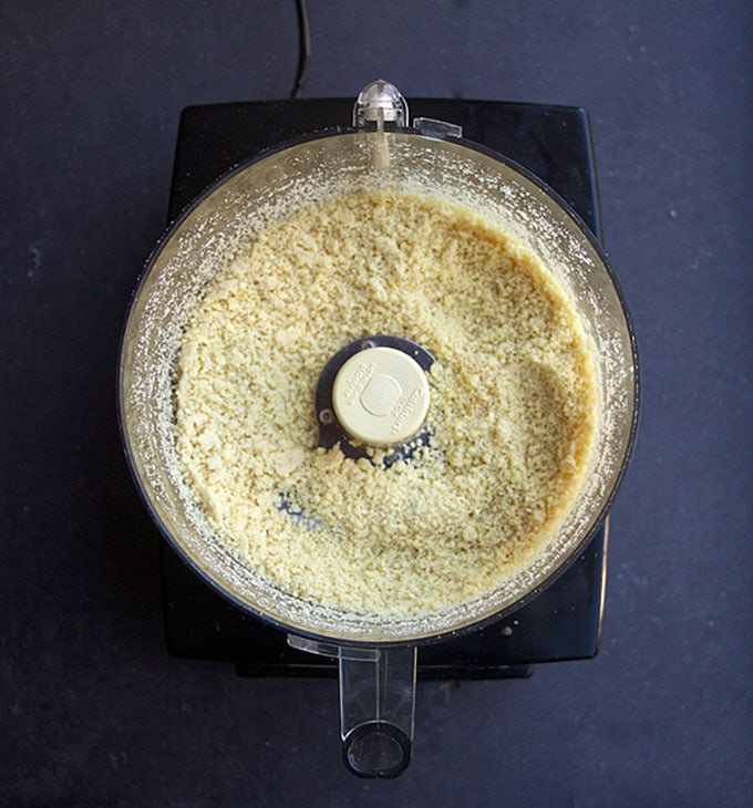 overhead shot of a food processor bowl with ground almonds